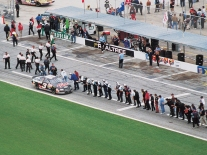 Teams line up to congratulate Dale Earnhardt after winning the 1998 Daytona 500